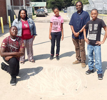 Hunt, students prepare for eclipse, study model of Solar System