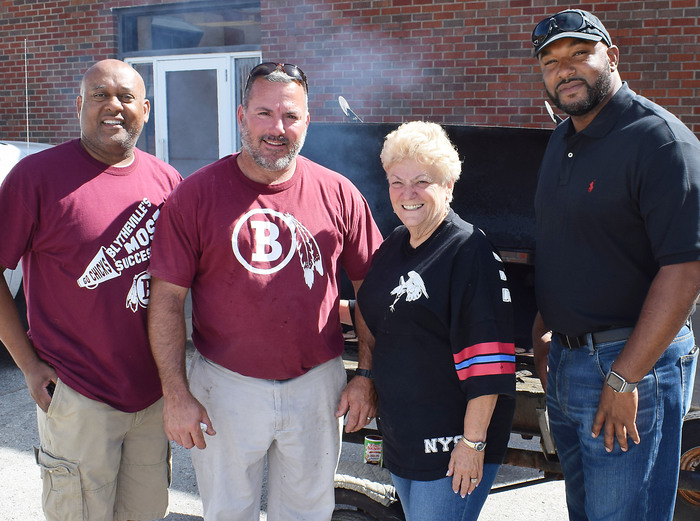 BSD superintendent Richard Atwill and members of the school board cooked the pregame meal for the Chickasaws. Board members include (from left) Billy Fair, Tobey Johnson and Desmond Hammett.