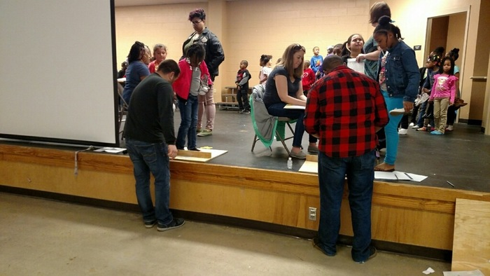 Wellspring Church measuring students for new shoes