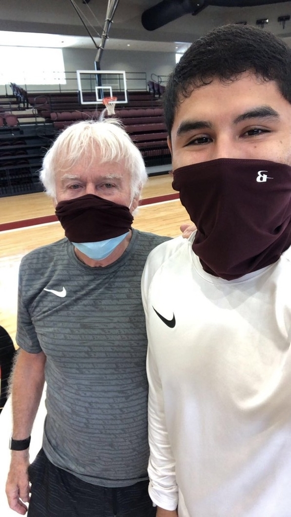 Coach Tyer and Coach Salazar in masks